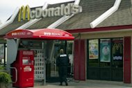 A policeman stands watch outside a McDonald&#39;s outlet in Baltimore on April 5. Mirlande Wilson - an assistant manager at the restaurant who had claimed at the start of the week that she held a winning Mega Millions ticket - told a Washington television station that she had &quot;misplaced&quot; it