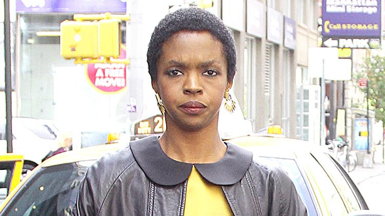 Lauryn Hill Leaves Her NYC Hotel Wearing A Long Dress.