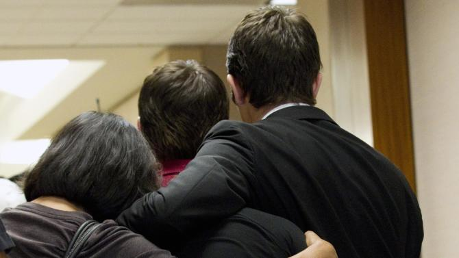 The family of Raul Rodriguez embrace as they leave the courtroom after Rodriguez was found guilty in the killing of Kelly Danaher  Wednesday, June 13, 2012, in Houston.  A jury convicted Rodriguez of murdering his neighbor during a confrontation outside the neighbor's home two years ago, rejecting his claim that he was within his rights to fatally shoot the man under Texas' version of a stand-your-ground law. (AP Photo/Houston Chronicle, Brett Coomer) MANDATORY CREDIT