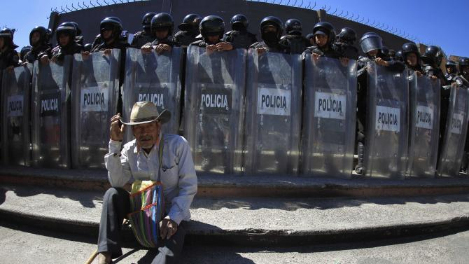 A man takes part in a protest by indigenous people outside the government palace of Guerrero state in Chilpancingo