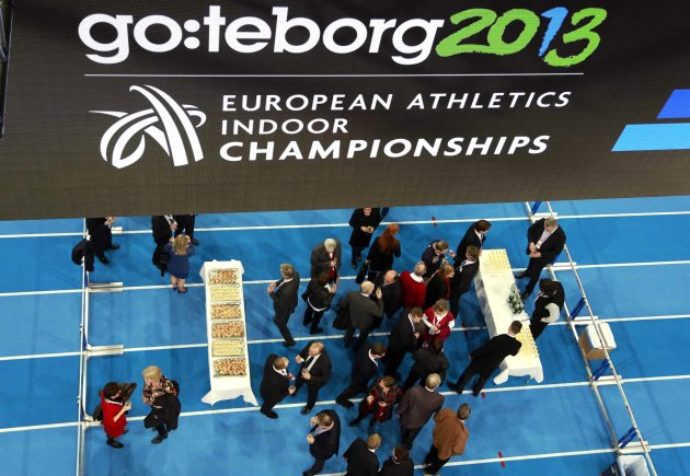 Officials gather on the track prior to the opening of European Indoor Athletics in Goteborg