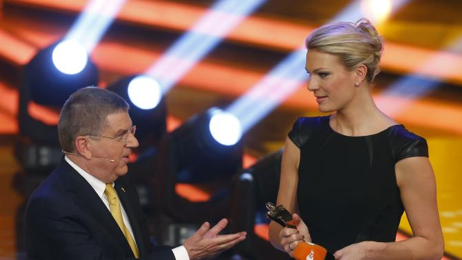 "Former Alpine skier Hoefl-Riesch receives the ""Sportswoman Of The Year"" trophy from IOC President Thomas Bach in Baden Baden"