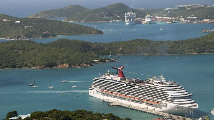 FILE - In this Jan. 5, 2010 file photo provided by Carnival Cruise Lines, the Carnival Dream is docked in St. Thomas, U.S. Virgin Islands. Carnival, the world's largest cruise line, has suffered through a number of high-profile mishaps, including on Thursday, March 14, 2013, when the company ended the voyage of the Carnival Dream after the ship's backup emergency diesel generator failed, causing problems with elevators and toilets. Yet passengers continue to book vacations thanks to discounts, albeit at a slower pace. Carnival Corp. said Friday, March 15, 2013, that it earned $37 million, or 5 cents per share, in first quarter ended Feb. 28. That compares with a loss of $139 million, or 18 cents per share, a year earlier. But its forecast for the year came in below analyst's predictions. Its shares fell more than 2 percent. (AP Photo/Carnival Cruise Lines, Andy Newman, File)