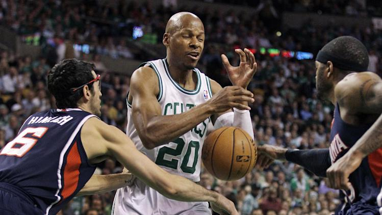 Boston Celtics shooting guard Ray Allen (20) loses control of the ball under pressure from Atlanta Hawks power forward Josh Smith, right, and guard Kirk Hinrich, left, during the first quarter of Game 6 of a first-round NBA basketball playoff series in Boston, Thursday, May 10, 2012. (AP Photo/Charles Krupa)