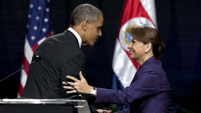 """President Barack Obama and Costa Rica's President Laura Chinchilla shake hands at the end of their joint press conference in San Jose, Costa Rica, Friday, May 3, 2013. Obama's three-day visit to Mexico and Costa Rica is his first to Latin America since winning a second presidential term. Obama on Friday cast Mexico as a nation ready to take """"its rightful place in the world"""" and move past the drug battles and violence that have defined its relationship with the United States. He then headed to Costa Rica to prod Central American leaders to tackle those same issues more aggressively. (AP Photo/Moises Castillo)"""