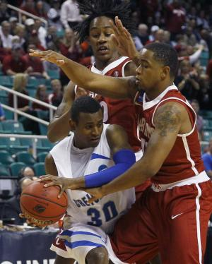 Creighton's Antoine Young, left, is trapped by Alabama's Levi Randolph, top, and Trevor Releford, right, during the first half of a Midwest Regional NCAA tournament second-round college basketball game in Greensboro, N.C., Friday, March 16, 2012. (AP Photo/Gerry Broome)
