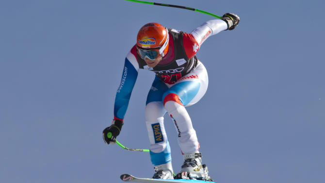 Patrick Kueng, of Switzerland, is airborne on the course during the men's World Cup downhill ski race in Beaver Creek, Colo., on Friday, Nov. 30, 2012. Kueng placed 13th in the race. (AP Photo/Nathan Bilow)