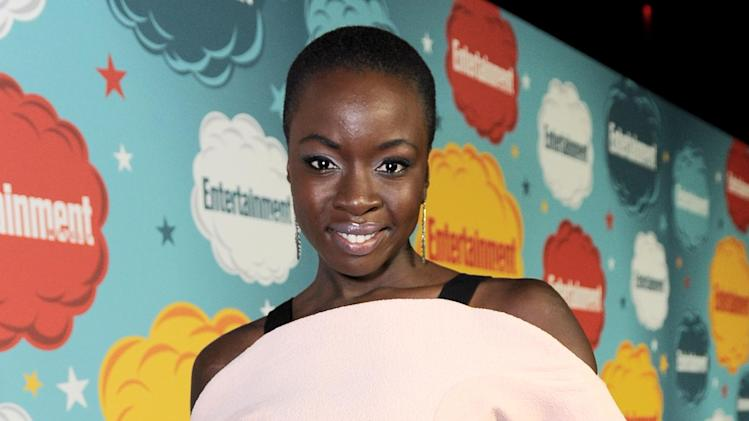 "FILE - This July 20, 2013 file photo released by Entertainment Weekly shows actress Danai Gurira at Entertainment Weekly's Comic-Con Celebration in San Diego. Gurira stars in the AMC series ""The Walking Dead,"" returning for a fourth season on Oct. 13. (AP Photo/Entertainment Weekly, Jordan Strauss, File)"