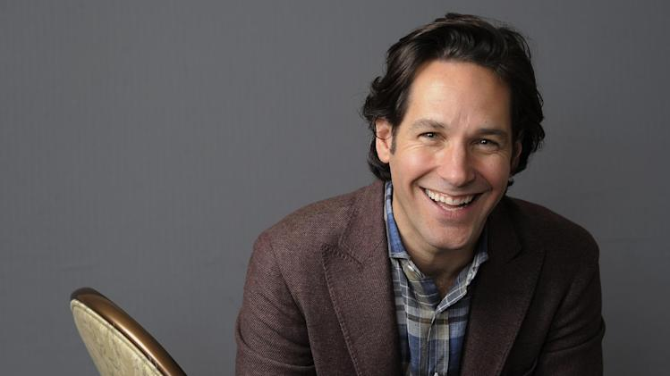 "In this Wednesday, Dec. 12, 2012 photo, Paul Rudd, a cast member in the film ""This is 40,"" poses for a portrait at The Four Seasons Hotel in Beverly Hills, Calif. Rudd stars with Apatow's real-life wife, Leslie Mann, and the couple's two daughters, Maude and Iris, in the comedy in theaters Friday, Dec. 21. Next up is ""Anchorman 2,"" and Rudd says, ""I could not be more excited about it.""  (Photo by Chris Pizzello/Invision/AP)"