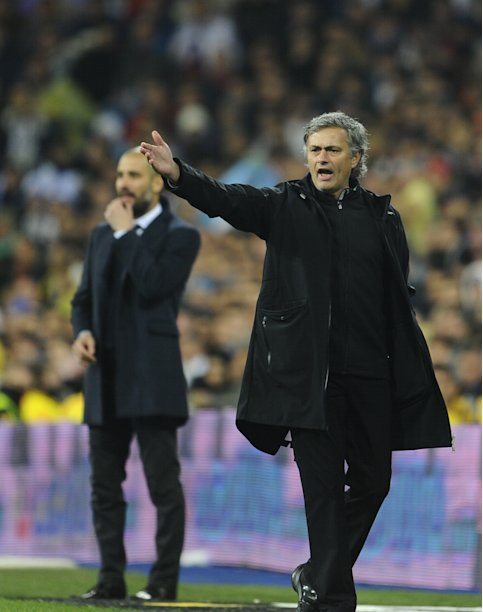 "Barcelona's coach Josep Guardiola (L) and Real Madrid's Portuguese coach Jose Mourinho attend the ""El clasico"" Spanish League football match Real Madrid against Barcelona at the Santiago Bernabeu stadium in Madrid on December 10, 2011.  AFP PHOTO / PIERRE-PHILIPPE MARCOU (Photo credit should read PIERRE-PHILIPPE MARCOU/AFP/Getty Images)"