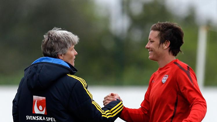 Abby Wambach, right, of the US, shakes hands with Sweden's head coach Pia Sundhage at the end of their Algarve Cup  women's soccer match Monday, March 11 2013, in Lagos, southern Portugal. The game ended in a 1-1 draw. Sundhage previously coached the US team. (AP Photo/Armando Franca)