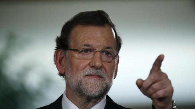 Spanish Prime Minister Mariano Rajoy gestures during a news conference after the weekly cabinet meeting in Moncloa Palace in Madrid