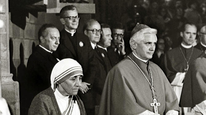 FILE - In this September 1978 file photo provided by the German Catholic News Agency KNA, Albanian-born Mother Teresa, left, and German Cardinal Joseph Ratzinger, right, attend a Mass during the 85th German Catholics Day in Freiburg, southern Germany, from Sept. 13-19, 1978. Ratzinger was elected Pope, April 19, 2005 and chose Benedict XVI as his papal name. Pope Benedict XVI announced Monday, Feb. 11, 2013, he would resign Feb. 28 because he is simply too old to carry on. (AP Photo/KNA, File)