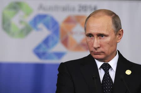 Russia's President Vladimir Putin attends a news conference at the end of the G20 summit in Brisbane