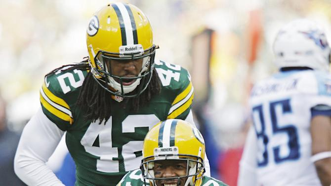 Green Bay Packers' Sam Shields (37) celebrates after intercepting a pass during the first half of an NFL football game against the Tennessee Titans Sunday, Dec. 23, 2012, in Green Bay, Wis. (AP Photo/Jeffrey Phelps)
