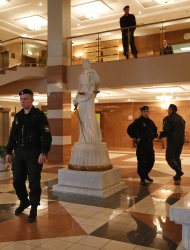 Special police guard a hall of the Moscow City Court where three members of the punk band Pussy Riot are set to make their case before a Russian appeals court that they should not be imprisoned, in Moscow, Wednesday. Oct. 10, 2012. Their impromptu performance inside Moscow's main cathedral in February came shortly before Putin was elected to a third term. The three women were convicted in August of hooliganism motivated by religious hatred and sentenced to two years in prison. (AP Photo/Sergey Ponomarev)