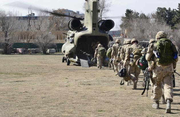 The last Canadians involved in the NATO training mission in Afghanistan board a U.S. Chinook helicopter in Kabul