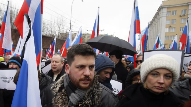 Leonid Volkov and Yulia Navalny attend a march to commemorate Kremlin critic Boris Nemtsov, who was shot dead on Friday night, in central Moscow