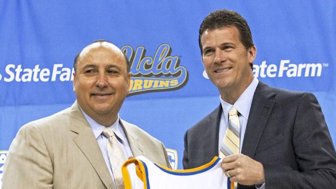 Dan Guerrero, left, UCLA athletic director, introduces Steve Alford as men's basketball coach during a news conference at Pauley Pavilion in Los Angeles on Tuesday, April 2, 2013. Alford was hired Saturday, spurning New Mexico days after he agreed to a new 10-year deal with the Lobos. (AP Photo/Damian Dovarganes)