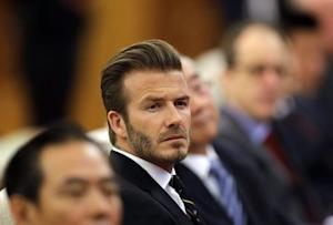 Former captain of England soccer team David Beckham attends a ceremony at the Great Hall of the People in Beijing