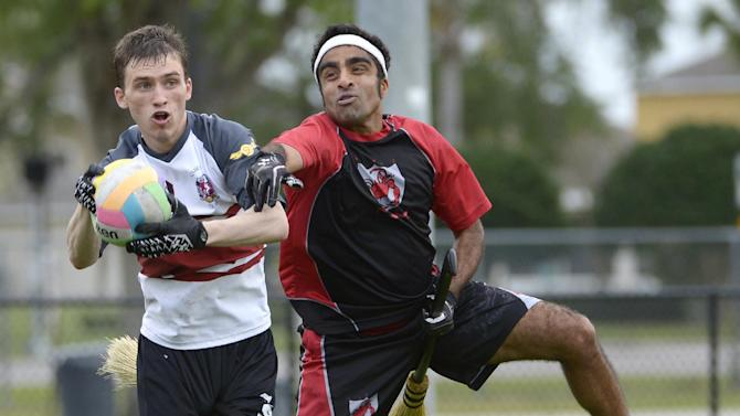 The University of Ottawa Quidditch team's Matthew McVeigh, left, and the Silicon Valley Skrewts' Sunil Venugopal battle for the quaffle during a scrimmage at the Quidditch World Cup in Kissimmee, Fla., Friday, April 12, 2013.  Quidditch is a game born within the pages of Harry Potter novels, but in recent years it's become a real-life sport.  The game is a co-ed, full contact sport that combines elements of rugby, dodgeball and Olympic handball. (AP Photo/Phelan M. Ebenhack)