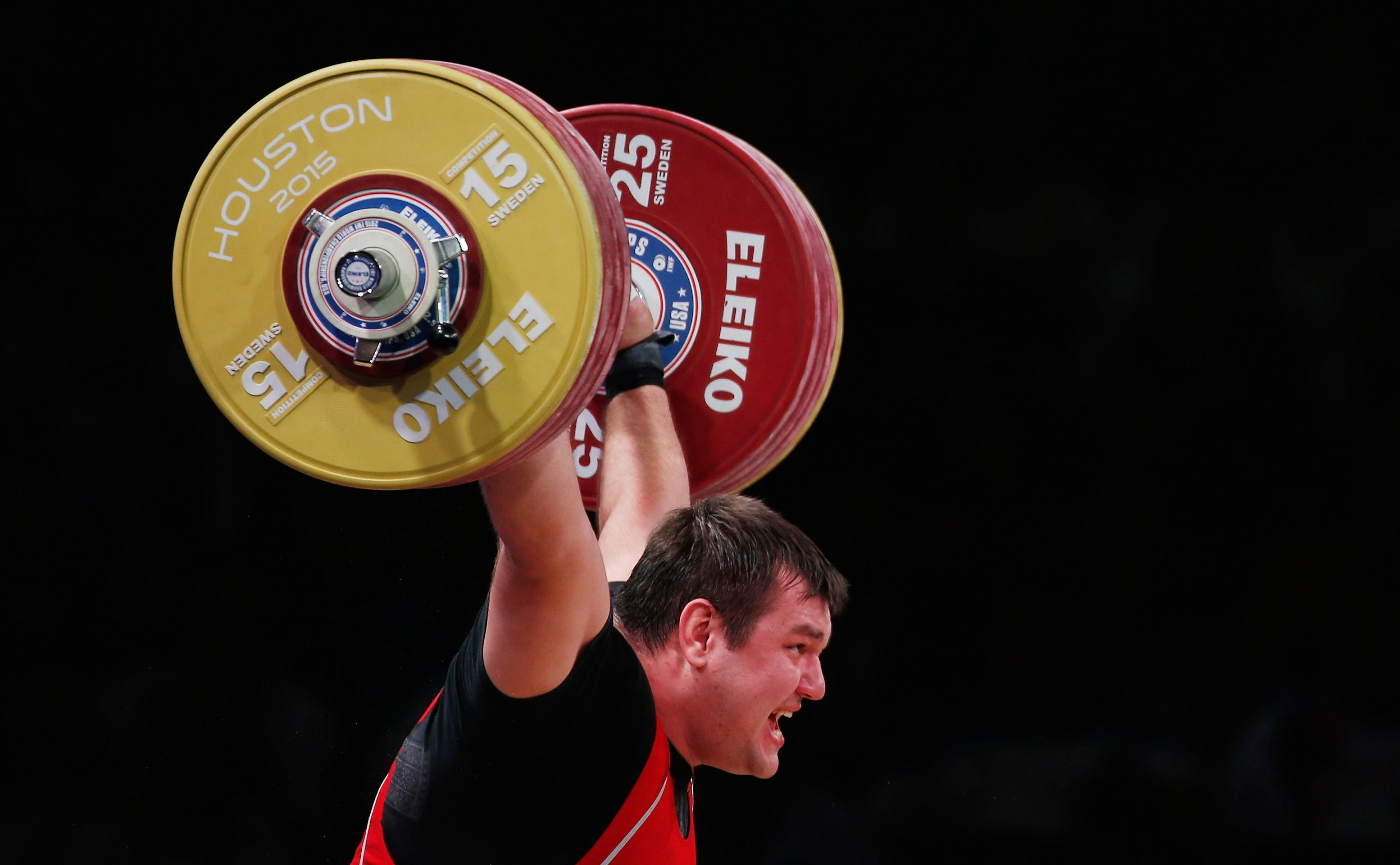 Russia's Lovchev breaks weightlifting world records at Houston