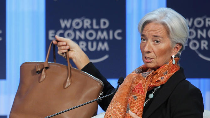International Monetary Fund, IMF, managing director Christine Lagarde shows her bag as she speaks during a session at the World Economic Forum in Davos, Switzerland, Saturday, Jan. 28, 2012.   (AP Photo/Michel Euler)