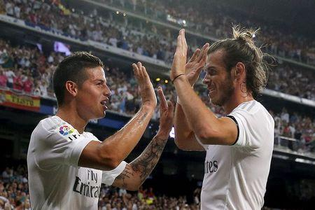Real Madrid's Rodriguez celebrates his goal against Real Betis with teammate Bale during their Spanish first division soccer match at Santiago Bernabeu stadium in Madrid, Spain