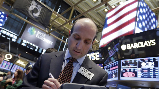 Trader James Denaro works on the floor of the New York Stock Exchange Tuesday, June 11, 2013. Global stock markets were mostly lower Wednesday June 19, 2013 as investors waited for an update on the U.S. economy from the Federal Reserve. (AP Photo/Richard Drew)