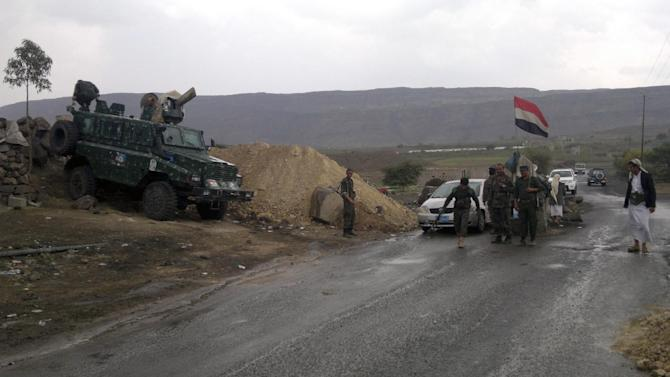 Yemeni army soldiers man a checkpoint leading to the capital Sanna, Yemen on August 19, 2014
