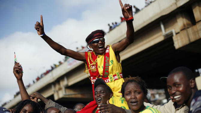 Supporters of Kenyan presidential candidate Uhuru Kenyatta celebrate what they perceive is an election win for him in Nairobi, Kenya Saturday, March 9, 2013. Kenya's election commission posted complete results early Saturday showing that Deputy Prime Minister Uhuru Kenyatta prevailed in the country's presidential elections by the slimmest of margins, winning 50.03 percent of the vote.(AP Photo/Jerome Delay)