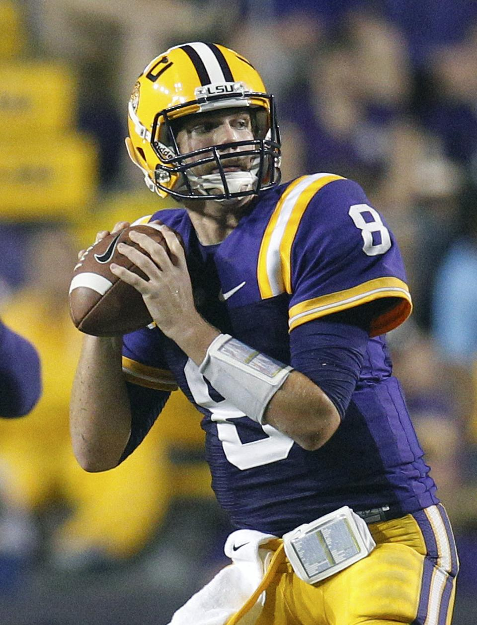 LSU quarterback Zach Mettenberger waits to throw to wide receiver Odell Beckham during the second half of an NCAA college football game against Towson in Baton Rouge, La., Saturday, Sept. 29, 2012. Mettenberger threw a 53-yard pass to Beckham on this play. (AP Photo/Bill Haber)