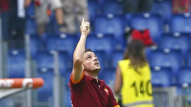 AS Roma's Alessandro Florenzi celebrates after scoring against Cagliari during their Italian Serie A soccer match at the Olympic stadium in Rome