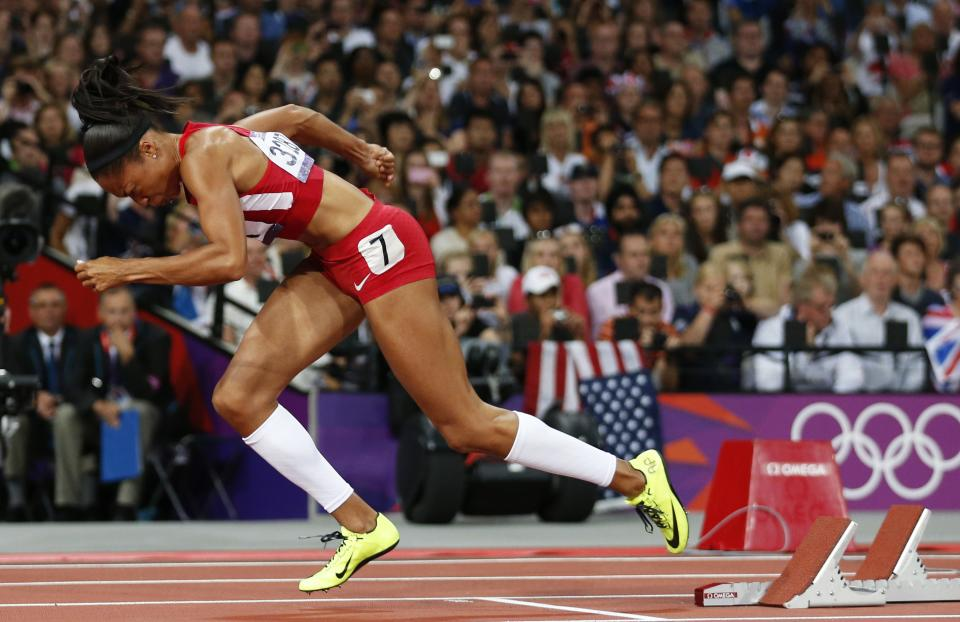 United States'  Allyson Felix starts in the women's 200-meter final during the athletics in the Olympic Stadium at the 2012 Summer Olympics, London, Wednesday, Aug. 8, 2012. (AP Photo/Matt Dunham)