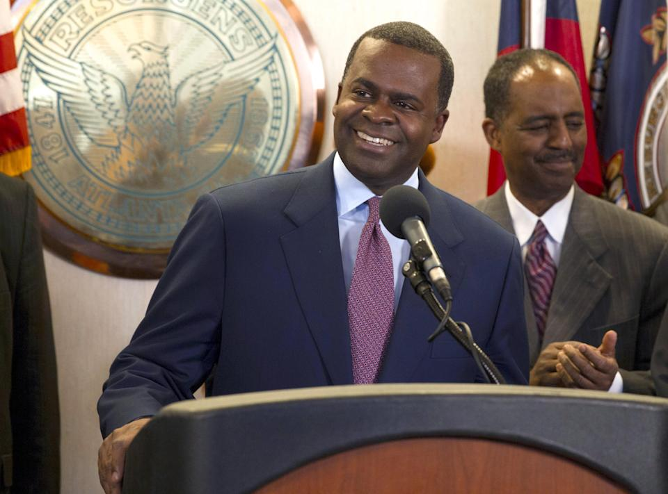 Atlanta Mayor Kasim Reed speaks during a news conference Thursday, March 7, 2013, in Atlanta, announcing that financing terms have been reached for the Atlanta Falcons' proposal to build a new $1 billion stadium, keeping the team's home games in the city's downtown. (AP Photo/Todd Kirkland)
