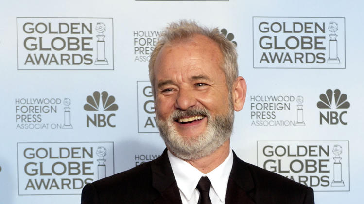 "FILE - In this Jan. 24, 2004 file photo, Bill Murray shows off his award for best actor in a musical or comedy for his work in ""Lost in Translation,"" at the 61st Annual Golden Globe Awards in Beverly Hills, Calif. (AP Photo/Reed Saxon, File)"