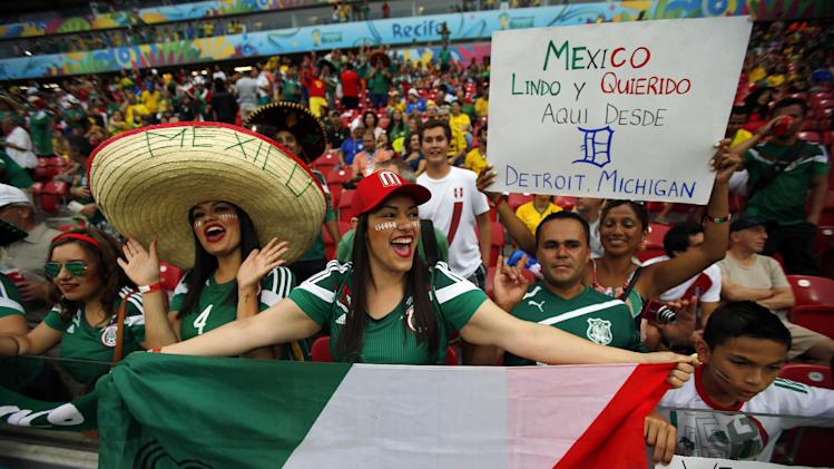 Mexico fans cheer prior to the group A World Cup soccer match between Croatia and Mexico at the Arena Pernambuco in Recife, Brazil, Monday, June 23, 2014. (AP Photo/Eduardo Verdugo)