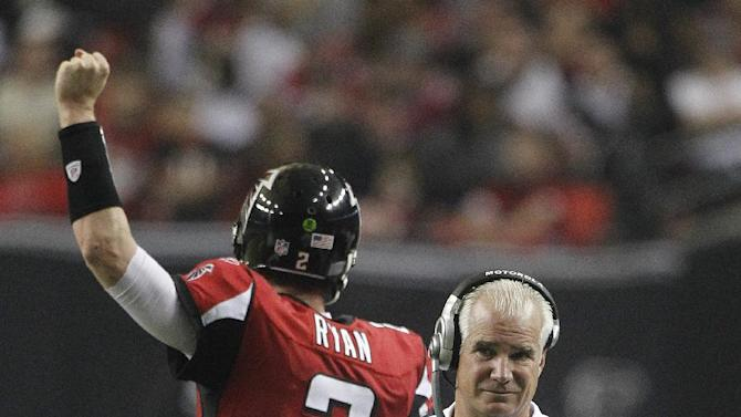 Atlanta Falcons coach Mike Smith watches a Falcons extra point during the first half of an NFL football game against the Tampa Bay Buccaneers on Sunday, Jan. 1, 2012, in Atlanta. Falcons quarterback Matt Ryan (2) is at left. (AP Photo/John Bazemore)