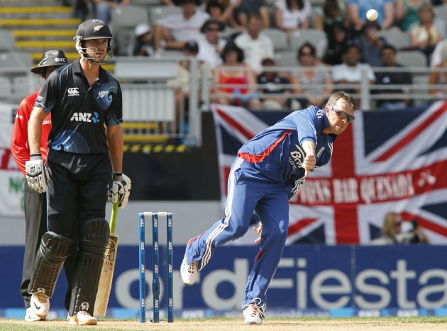 Swann of England bowls as he is watched by Franklin of New Zealand during the final cricket match of their one day international series at Eden Park, Auckland