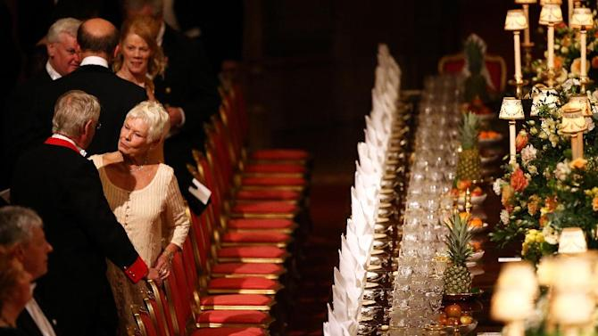 Britain's actress Dame Judy Dench, centre left, attends a State Banquet in honour of the President of Ireland Michael D. Higgins, at Windsor Castle Tuesday April 8, 2014, in Windsor, England. Guests and dignitaries including Irish Prime Minister, Enda Kenny and Northern Ireland's Deputy First Minister Martin McGuinness are attending the banquet at the end of the first day of a state visit by Ireland's Michael D. Higgins. Ireland's Michael D. Higgins is making the first state visit by a president of the republic since it gained independence from Britain. (AP Photo / Dan Kitwood)