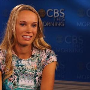 What advice did Meb Keflezighi give Caroline Wozniacki as she prepares for the 2014 NYC marathon?
