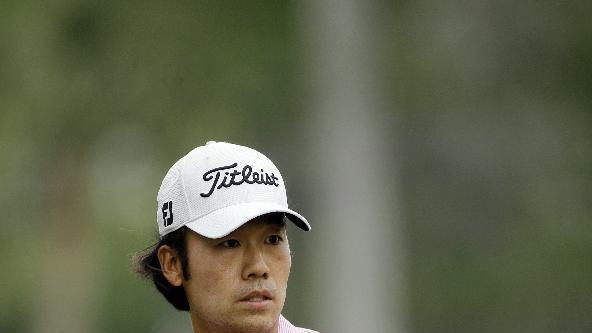 Kevin Na gestures to his ball on the third green during the final round of the Players Championship golf tournament at TPC Sawgrass, Sunday, May 13, 2012, in Ponte Vedra Beach, Fla. (AP Photo/David Goldman)