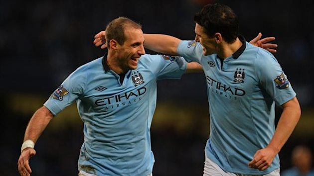 Manchester City's Argentinian defender Pablo Zabaleta (L) celebrates scoring the opening goal with Manchester City's English midfielder Gareth Barry (R) during the English Premier League football match between Manchester City and Stoke City