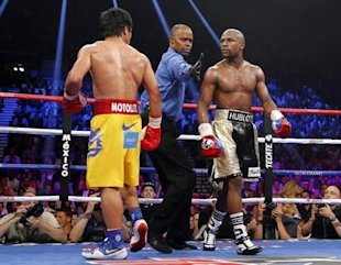 Manny Pacquiao and Floyd Mayweather Jr. stare each other down at the conclusion of a round on May 2. (Reuters)