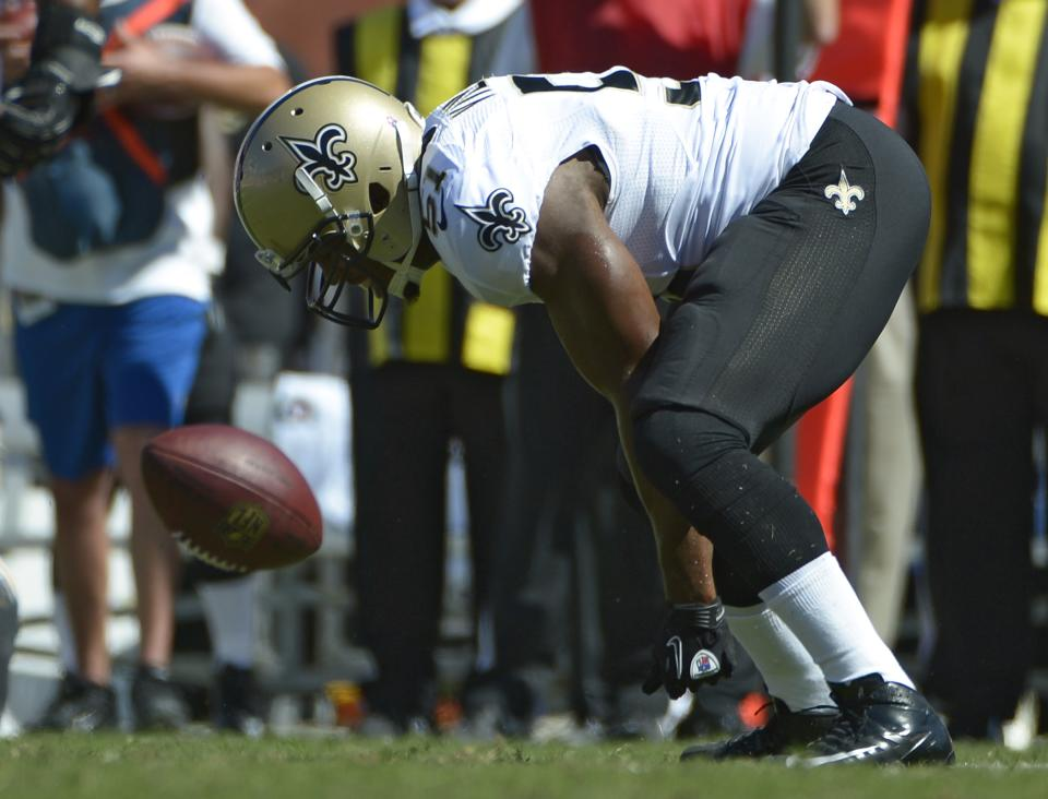 ADDS ADDITIONAL DETAILS--- New Orleans Saints linebacker Jonathan Vilma (51) bends over in front a loose football after an incomplete pass during the first quarter of an NFL football game against the Tampa Bay Buccaneers Sunday, Oct. 21, 2012, in Tampa, Fla. (AP Photo/ Phelan Ebenhack)