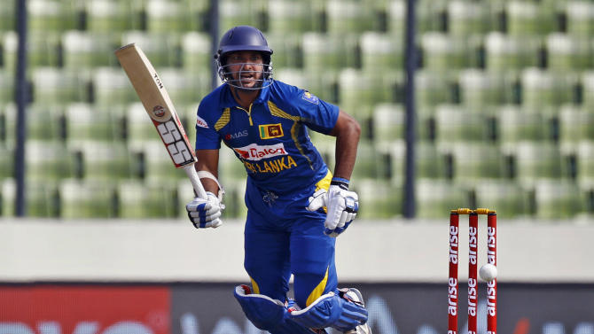 Sri Lanka's Kumar Sangakkara plays a shot during the Asia Cup one-day international cricket tournament against Afghanistan in Dhaka, Bangladesh, Monday, March 3, 2014. (AP Photo/A.M. Ahad)