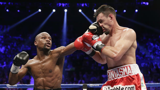 Floyd Mayweather Jr. lands a left jab against Robert Guerrero in the fourth round during a WBC welterweight title fight, Saturday, May 4, 2013, in Las Vegas. (AP Photo/Isaac Brekken)
