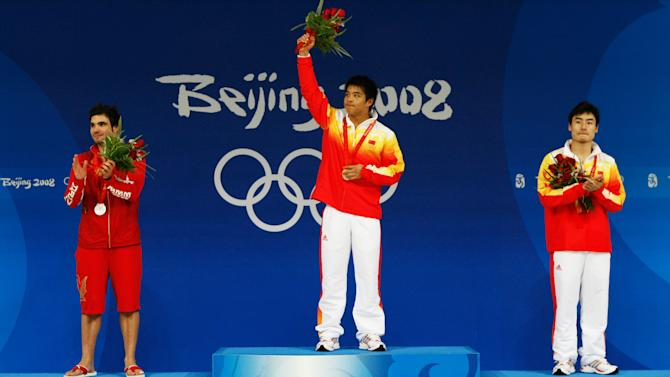 Silver medallist Alexandre Despatie on the podium at the 2008 Olympics in Beijing.