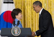 US President Barack Obama and South Korean President Park Geun-Hye shake hands during a joint press conference in the East Room of the White House in Washington, DC, on May 7, 2013. The two leaders pledged to bolster defense cooperation and demanded that North Korea change course on its nuclear program before any new talks