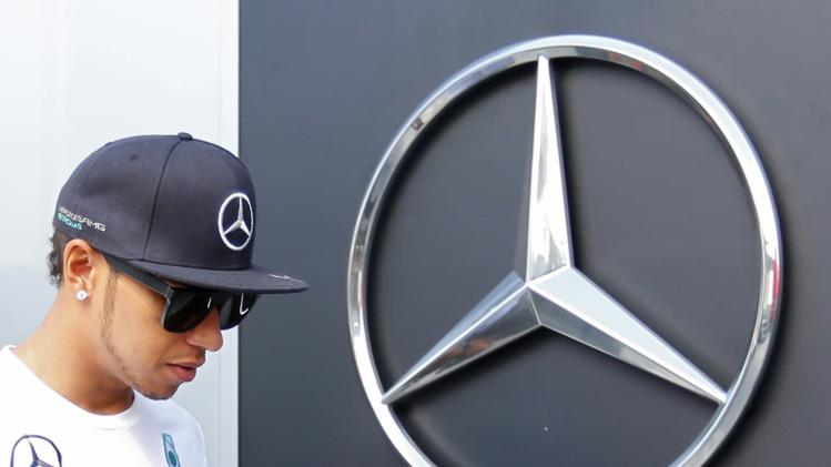 Mercedes Formula One driver Lewis Hamilton of Britain walks in at the Hungaroring circuit, near Budapest